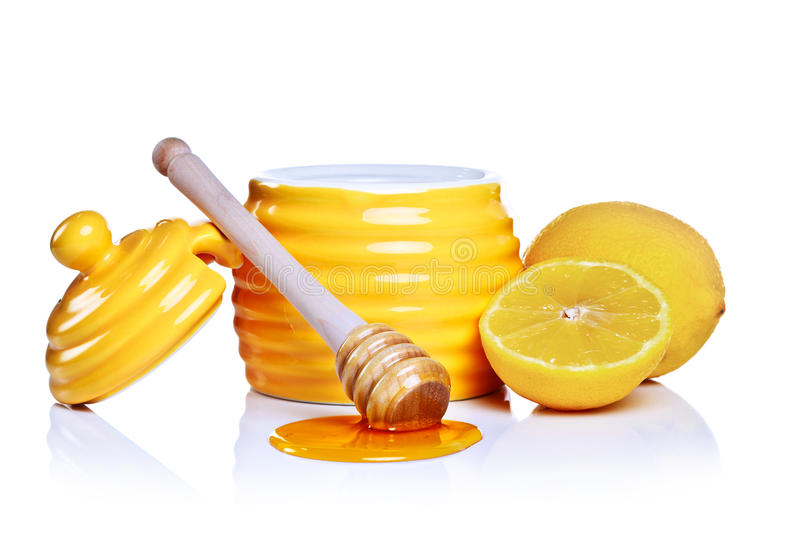 Download Honey And Lemon Isolated On A White Background. Stock Photo - Image: 20534980