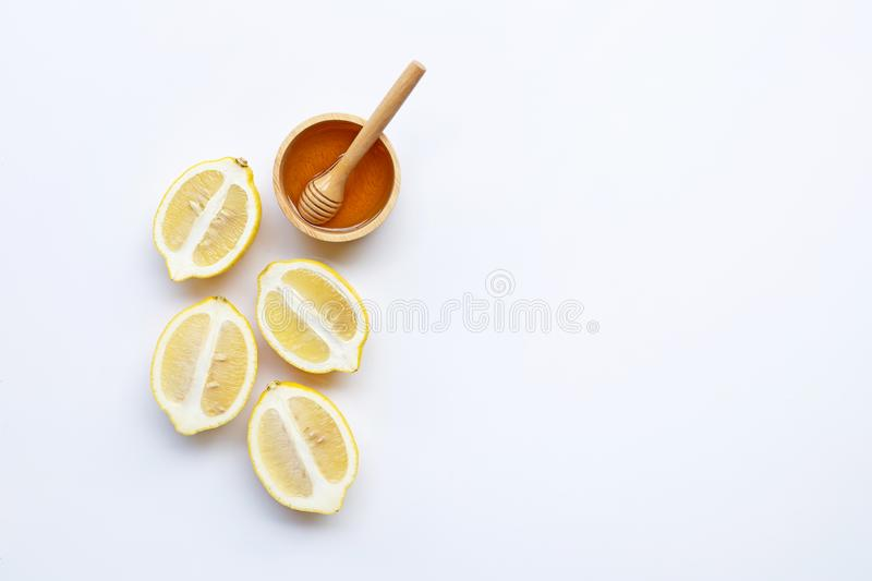 Honey with lemon on white background. Copy space. Top view royalty free stock image