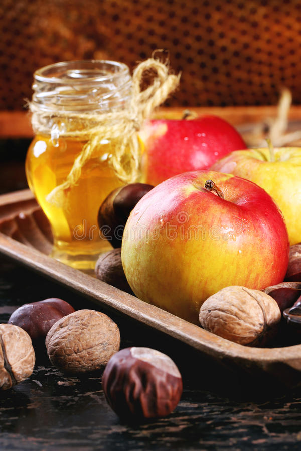 Honey, nuts and apples royalty free stock image