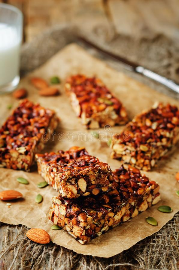 Honey nuts bars with milk. On a wood background. toning. selective focus royalty free stock image