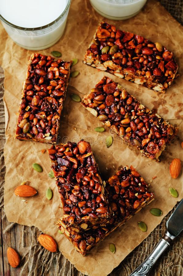 Honey nuts bars with milk. On a wood background. toning. selective focus royalty free stock photo