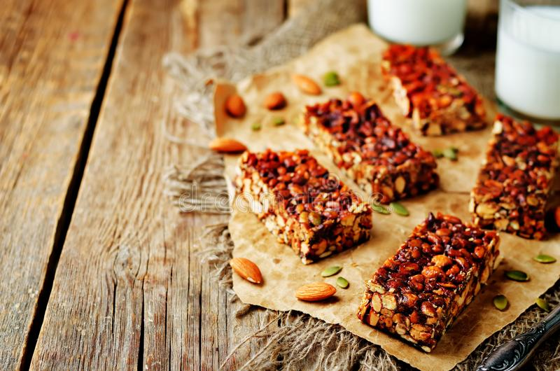 Honey nuts bars with milk. On a wood background. toning. selective focus stock image
