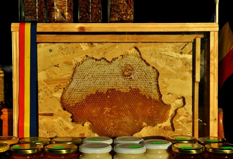 Honey, nuts and seeds stock images