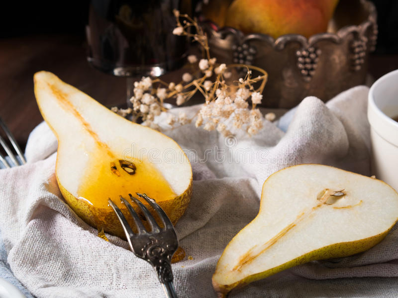 Honey on pears royalty free stock image