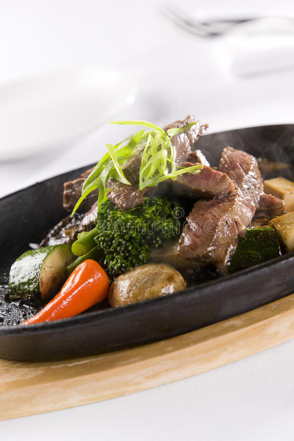 Honey & Pepper Sizzling Beef and vegetables royalty free stock photo