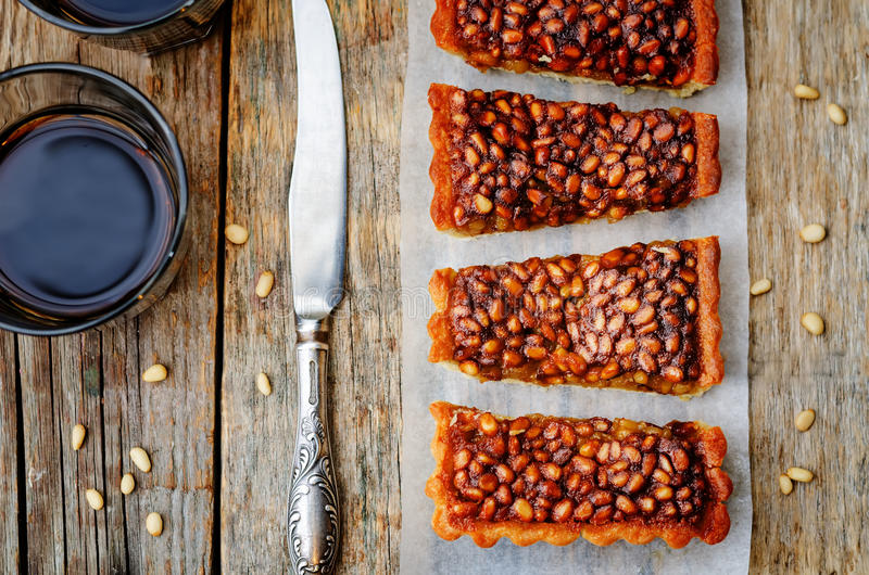 Honey pine nuts tart. On a dark wood background. toning. selective Focus stock photography