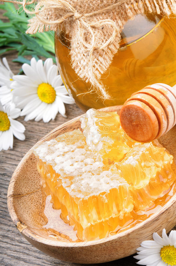 Honey pot and comb royalty free stock image