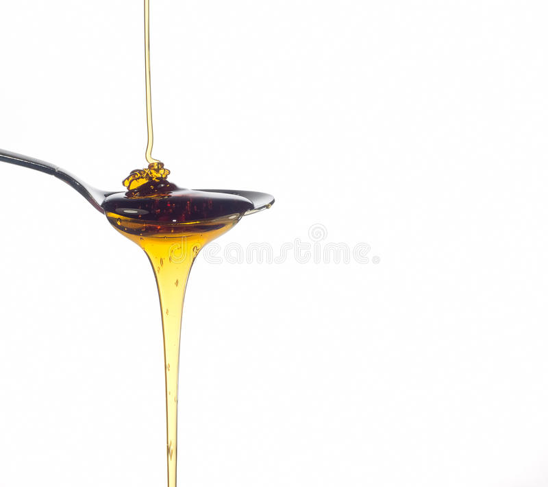 Honey pouring royalty free stock images