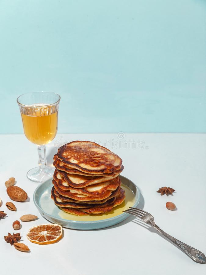 Honey pouring over a stack of mini pancakes. The concept of a delicious breakfast royalty free stock photography