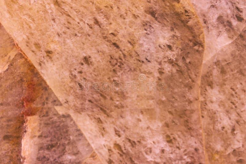 Honey quartz texture toned pink, gemstone surface background stock photos