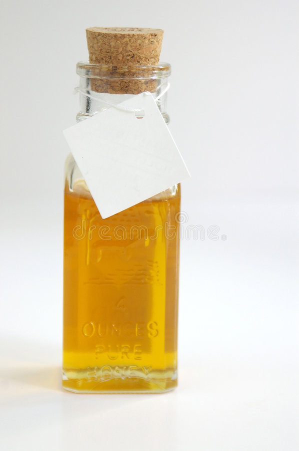 Honey in small container stock photography