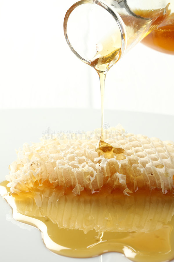 Free Honey Spill From Honeycomb Class. Stock Image - 8078131