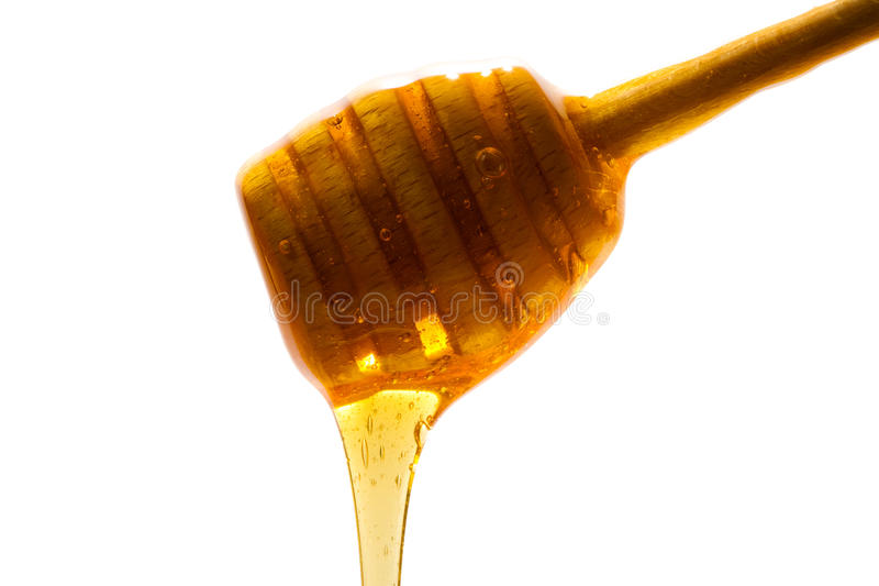 Honey spoon royalty free stock photography