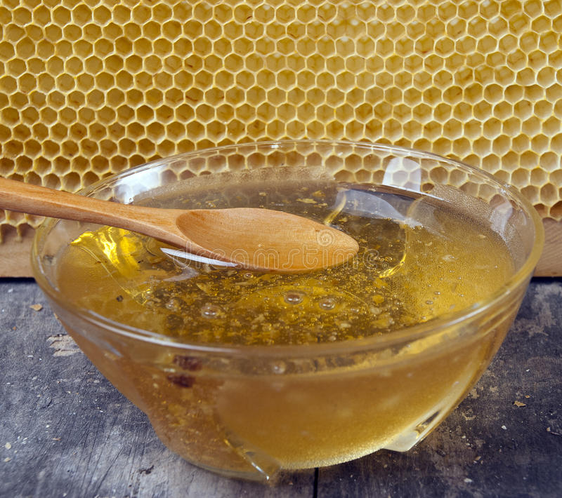 Download Honey With A Spoon On The Wooden Table Stock Image - Image of almendro, ingredient: 26812907