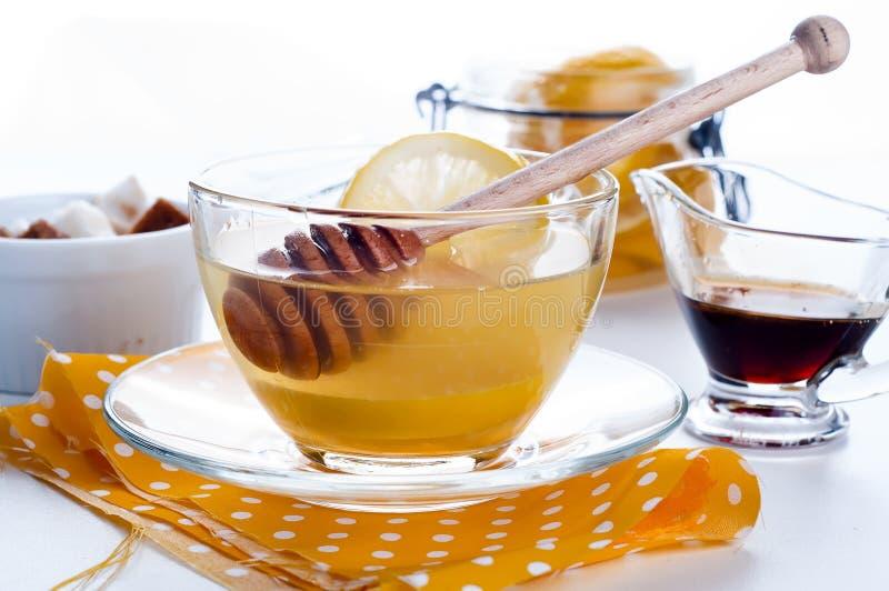 Honey, tea and lemon stock photos