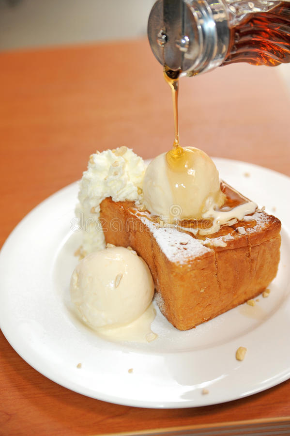 Honey on toast and icecream stock images