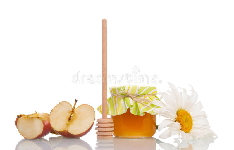 Honey on wooden dipper and jar stock photo