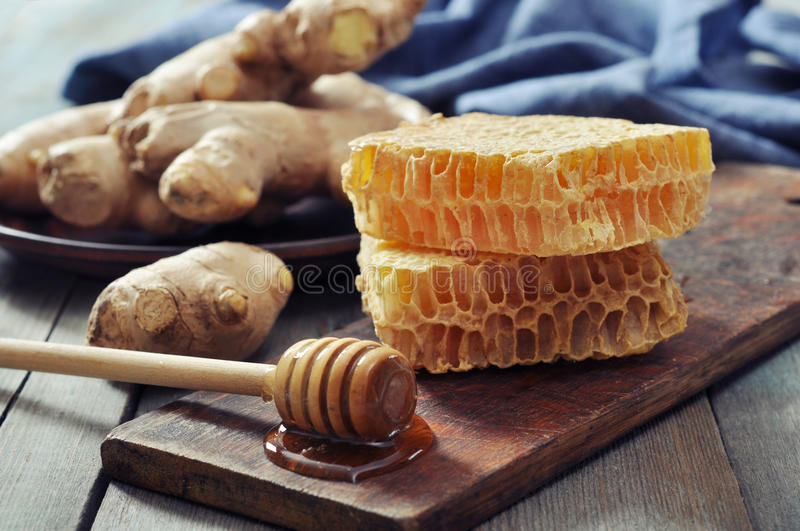 Honeycomb with fresh ginger stock images