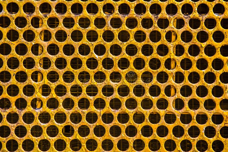 Honeycomb Grid of Radiator of tractor - Phetchabun, Thailand. The pattern of Honeycomb Grid.Radiator of tractor in Phetchabun, Thailand royalty free stock photos