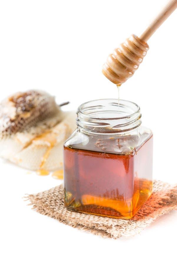 Honeycomb and honey isolated royalty free stock image