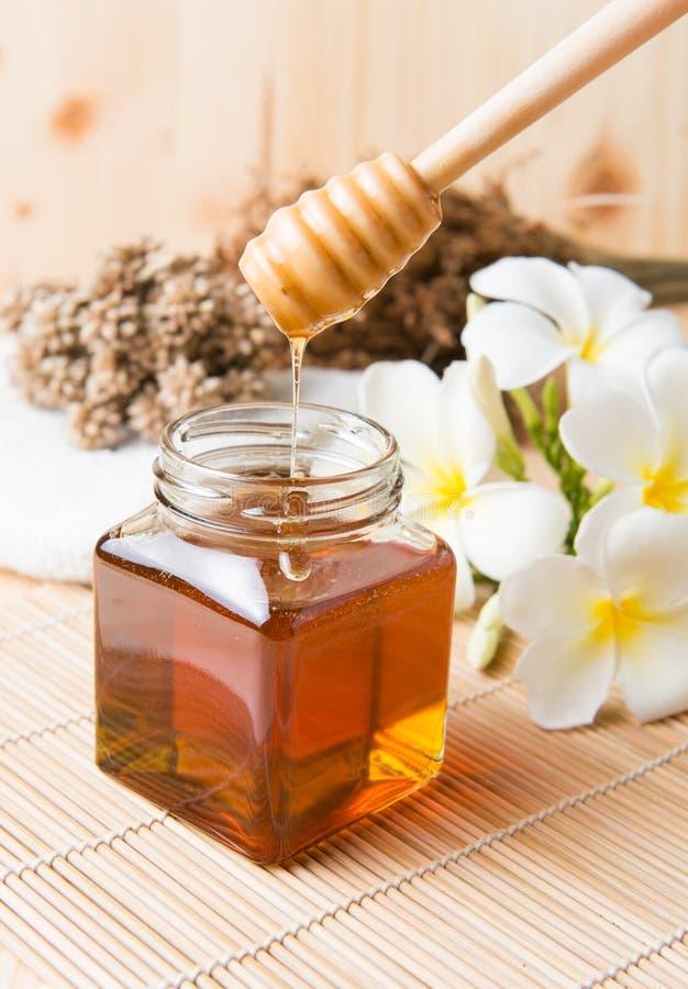 Honeycomb, honey on wooden background royalty free stock image