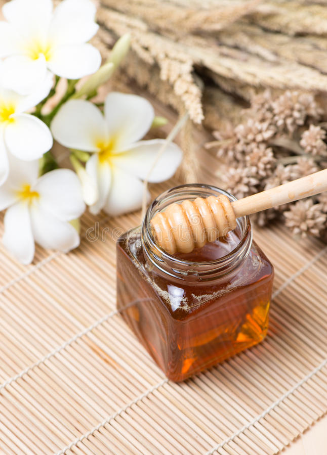 Honeycomb, honey on wooden background royalty free stock photography
