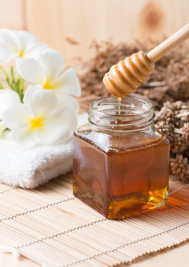 Honeycomb, honey on wooden background stock photography