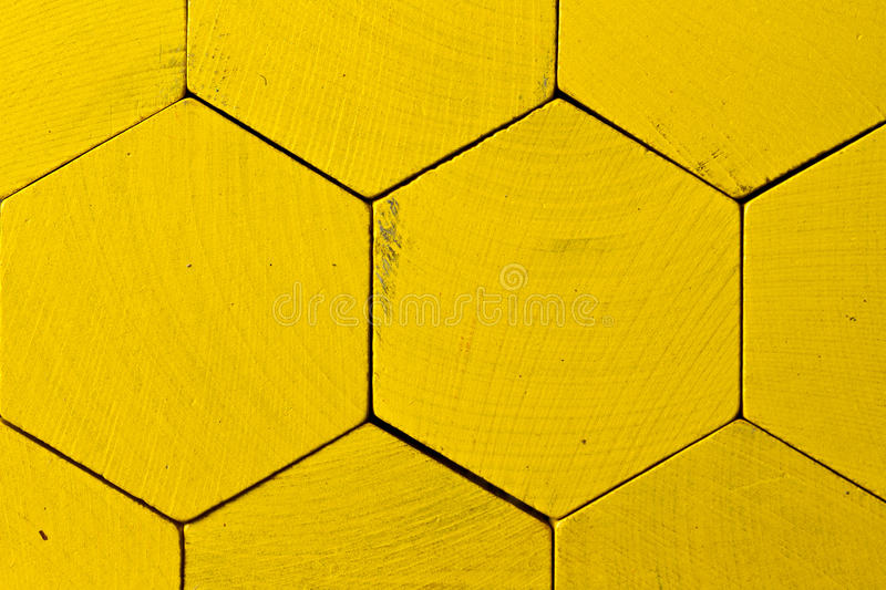 Honeycomb pattern. Yellow honeycomb or hexagon pattern of yellow tiles stock photo