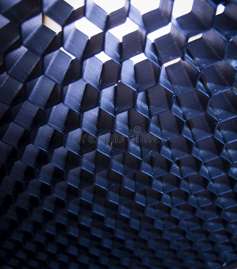 Honeycomb pattern. Blue three-dimensional honeycomb pattern with translucent light royalty free stock photography