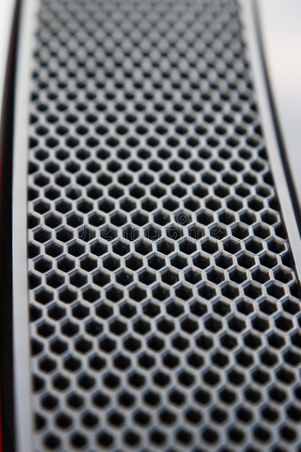 Honeycomb Pattern. Close up of a sports car's rear vent with a honeycomb pattern stock images