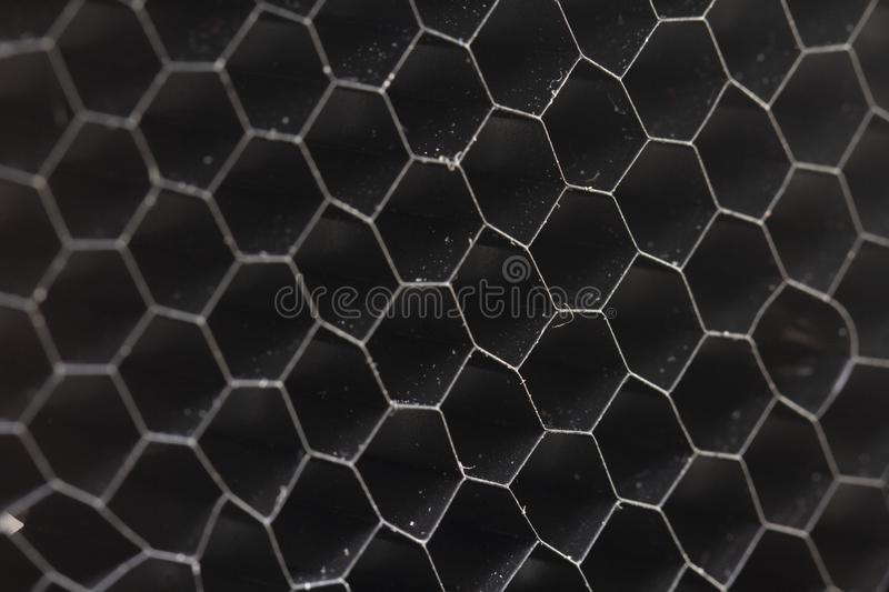 Honeycomb pattern on the black rubber mats. Close up stock photos