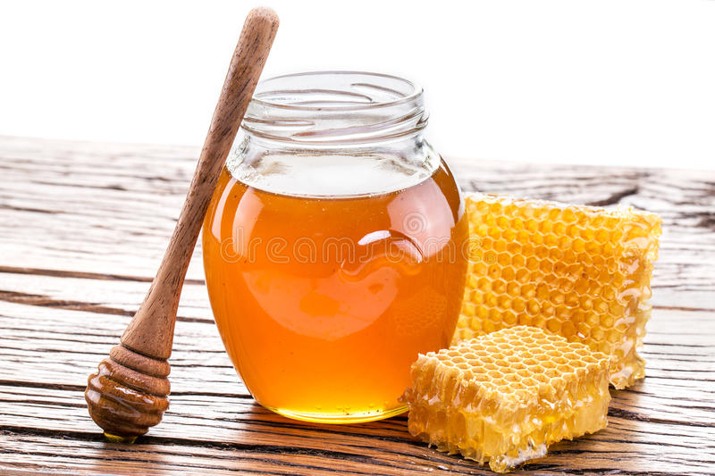 Honeycomb and pot of fresh honey. High-quality picture contains. Clipping paths royalty free stock images