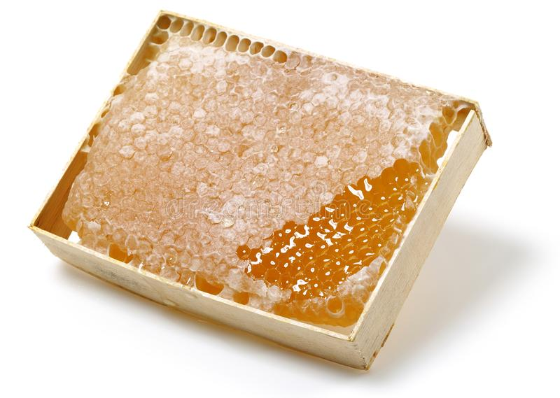 Honeycomb in wooden frame. Isolated on white background stock photos