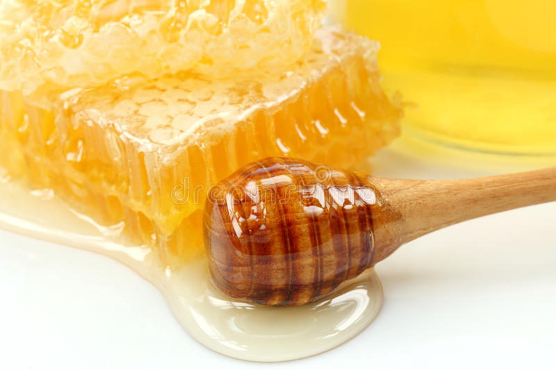Honeycomb and wooden stick royalty free stock photography
