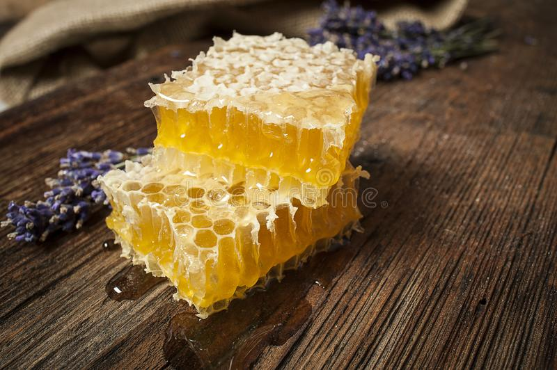 Fresh honey close up. Honeycomb on a wooden table close up stock image