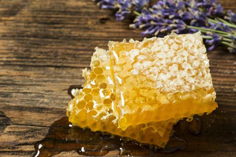 Honeycomb on a wooden table. Close up royalty free stock photography