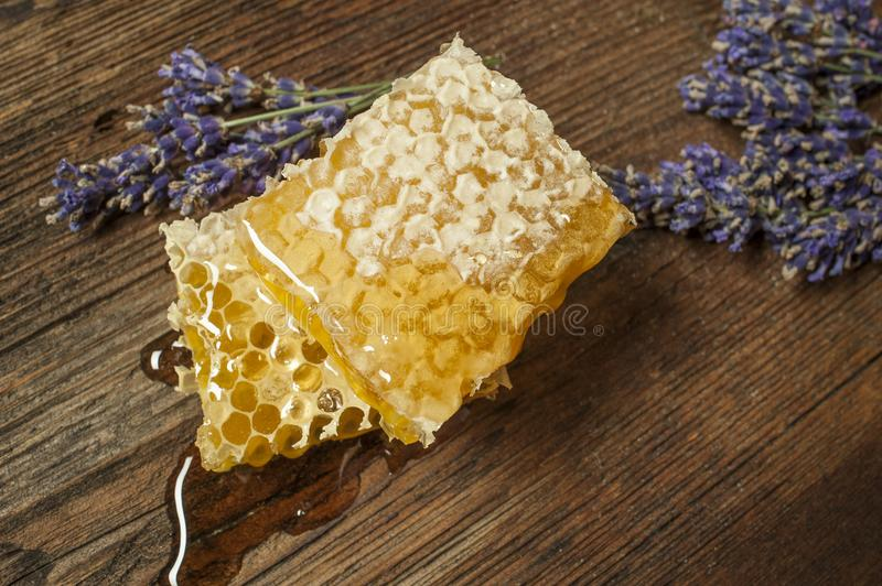 Honeycomb on a wooden table. Close up stock photos