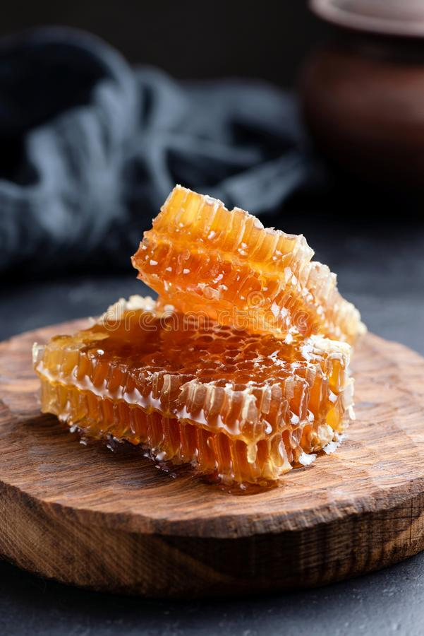Honeycombs on wooden board. Raw honey. Natural organic honey. Selective focus, rustic style royalty free stock photography