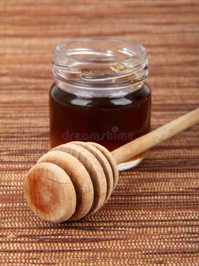 Honeydew honey. In jars with wooden spoon stock photo