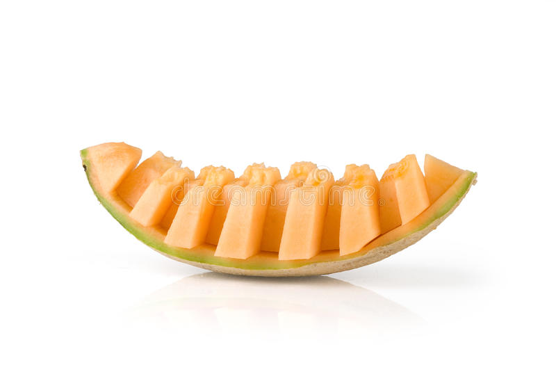 Honeydew. Juicy honeydew melon on a white background royalty free stock photo