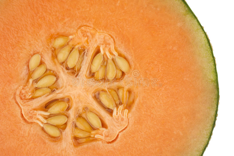 Honeydew melon in close up. One side of an orange honeydew melon in closeup stock photos