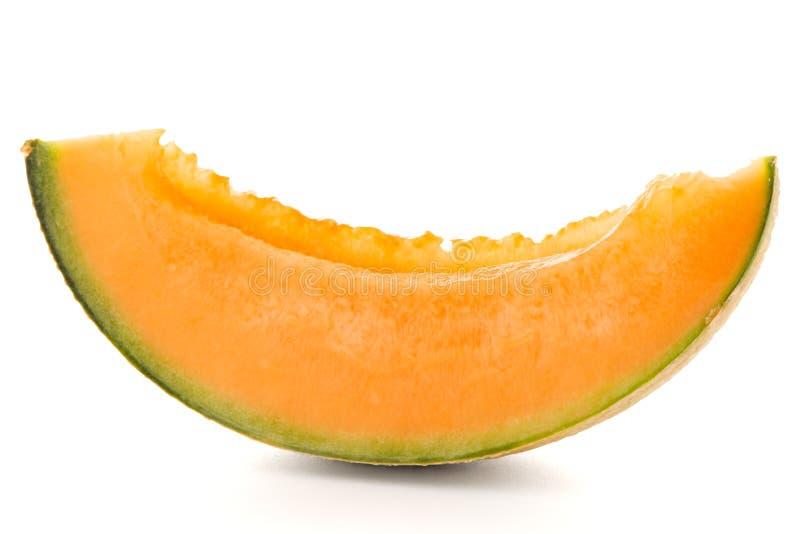 Honeydew melon. Juicy honeydew melon on a white background royalty free stock photo