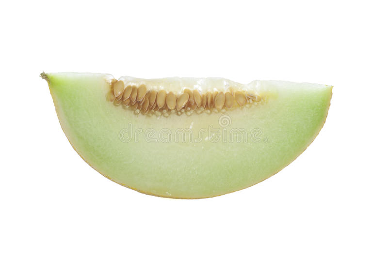 Honeydew Melon Slice. Isolated on a white background royalty free stock image