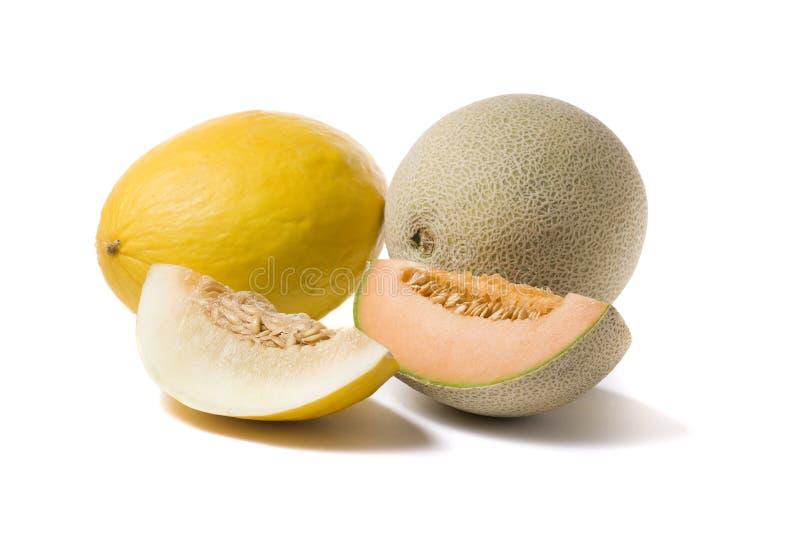 Honeymelon, cantaloupe melon and slices stock photos