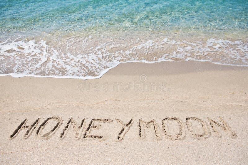 Honeymoon. Written on the sand stock photography