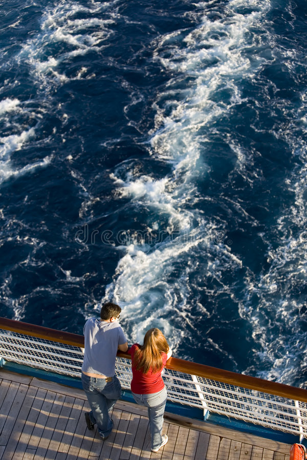 Honeymoon Cruise. A honeymoon couple looking off the back of a cruise ship stock photography