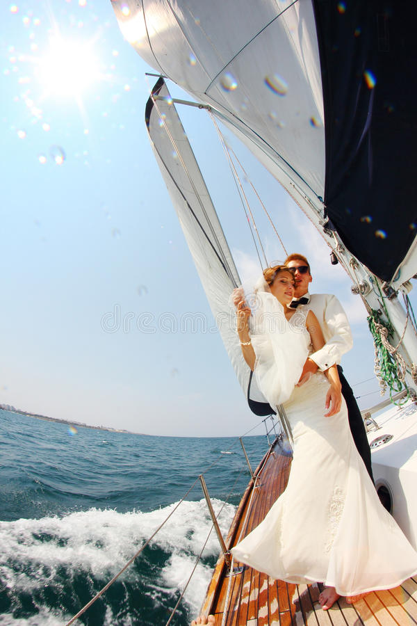 Honeymoon cruise sailing. Honeymoon sailing cruise on a luxury yacht royalty free stock photo