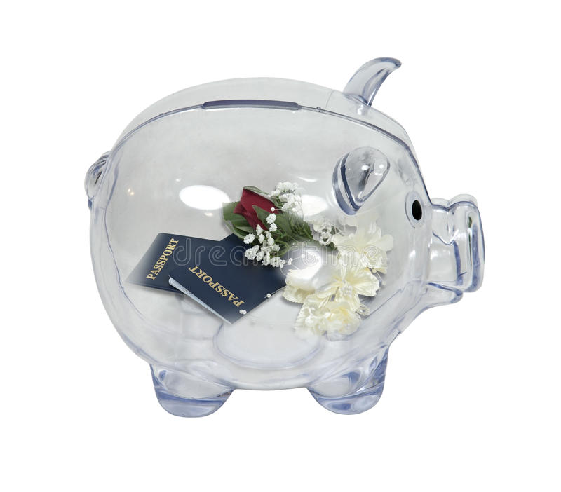 Honeymoon Savings. Shown by a piggy bank in profile with passports with a corsage and boutonniere inside - path included stock photography