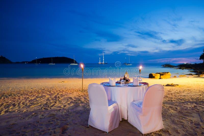 Honeymoon seat. On the beach stock photos