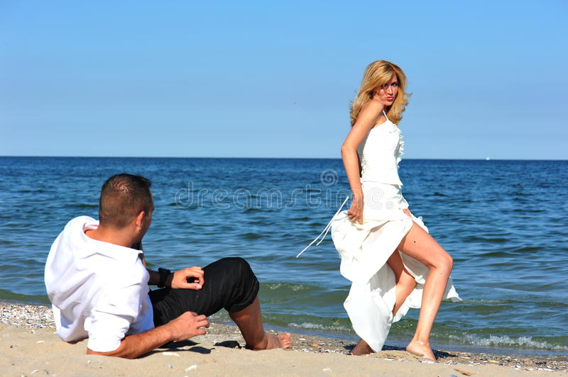 Honeymoon temptation - bride and groom royalty free stock images